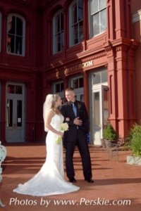 Bride and Groom Portrait in Front of Fava Building