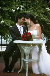 Bride and Groom Posing at Table in Plaza Courtyard